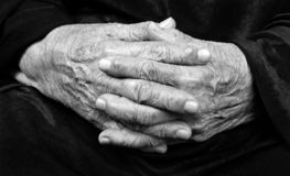 Wrinkled hands of an old woman. Mother`s native hands. Black and white photography. stock photo