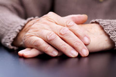 Wrinkled hands Stock Images