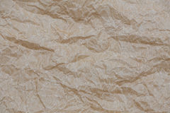 Wrinkled kraft paper. Top view brown crumpled paper background texture.  Royalty Free Stock Photography