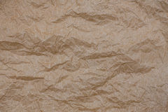 Wrinkled kraft paper. Top view brown crumpled paper background texture.  Royalty Free Stock Image