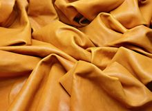 Wrinkled light brown leather lay down to the table stock photography