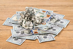Wrinkled money on a pile of smooth Stock Photo