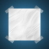 Wrinkled note on blank wall Royalty Free Stock Image