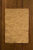Wrinkled note paper on wood Royalty Free Stock Photo