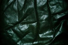 Wrinkled old black leather Stock Photography