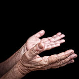 Wrinkled old hands begging Royalty Free Stock Images