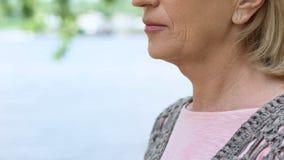 Wrinkled old woman close up, thyroid gland illness, medical examination, health. Stock photo stock photos