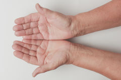 Wrinkled on old woman hand skin Stock Images