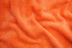 Wrinkled orange blanket Stock Images