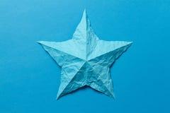 Wrinkled origami star Stock Image