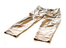Wrinkled pants 0017. A beige wrinkled pants on a white background Royalty Free Stock Image