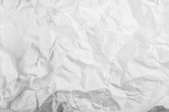 Wrinkled paper. Wrinkled white paper texture background Stock Images