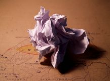 Wrinkled paper. Crunched paper on top of a geographical map Royalty Free Stock Image