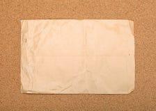 Wrinkled paper on corvkboard. Stock Image