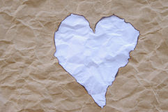Wrinkled paper cutting and burning heart shape Royalty Free Stock Images