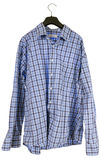 Wrinkled plaid shirt hanging on a hanger Stock Photography