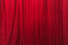 Wrinkled red curtain. Texture, cloth material with wrinkles as background Royalty Free Stock Photo