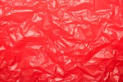 Wrinkled red plastic sheet for background or text stock photography