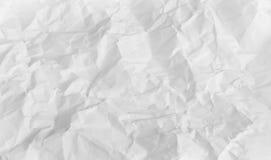 Wrinkled sheet of white paper stock photo
