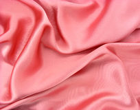 Wrinkled shiny pink fabric Royalty Free Stock Photography