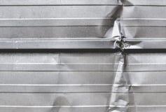 Wrinkled silver metal sheet Stock Images