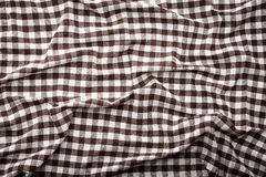 Wrinkled tablecloth braun tartan in cage texture wallpaper. Royalty Free Stock Images