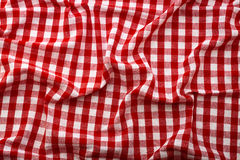 Wrinkled tablecloth red tartan in cage texture wallpaper. Unique perspectives top view Stock Photography