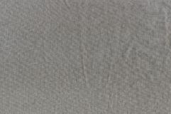 The wrinkled texture of linen cloth brown. Royalty Free Stock Image