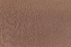 The wrinkled texture of linen cloth brown. Royalty Free Stock Images