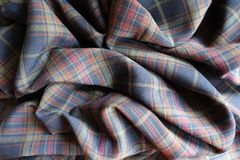 Wrinkled thick plaid fabric in subdued colors. Wrinkled thick plaid fabric  in subdued colors Stock Photo