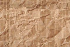 Wrinkled torn corrugated cardboard Stock Images