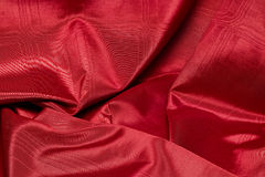 Wrinkled up luxurious red satin cloth Stock Image