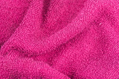 Wrinkled wash cloth. Wrinkled texture background made of a pink dish towel Stock Photography