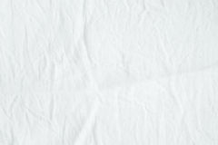 Wrinkled white cotton fabric texture background, wallpaper Royalty Free Stock Images