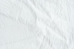Wrinkled white cotton fabric texture background, wallpaper Stock Photo