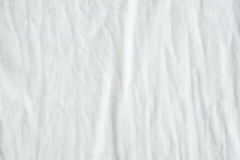 Wrinkled white cotton fabric texture background, wallpaper Stock Images