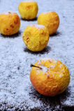Wrinkled yellow apples in the snow Royalty Free Stock Photos
