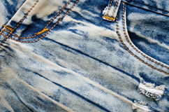 Wrinkles blue jeans texture. Jeans background Stock Photos