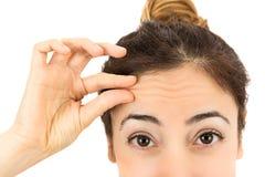 Wrinkles on female forehead Royalty Free Stock Image