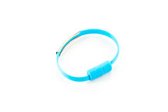 Wrist band blue wire USB. Isolated on white background stock photos