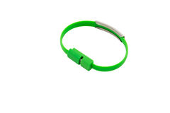 Wrist band green wire USB. Isolated on white background royalty free stock photo