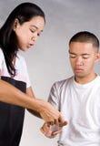 Wrist bandage. A nurse applying bandage on the arm royalty free stock images