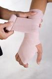 Wrist bandage. A nurse applying bandage on the arm Stock Photos