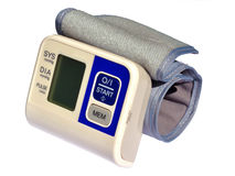 Wrist blood pressure monitor Stock Photo