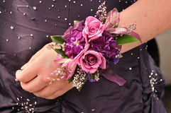 Wrist Corsage. Purple and Pink Flowers (Roses) on Wrist Corsage for Prom Stock Photos