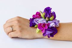 Wrist corsage made of violet and purple eustoma flowers Stock Image