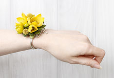 Wrist corsage made of yellow flowers Stock Image