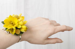 Wrist corsage made of yellow flowers Stock Images