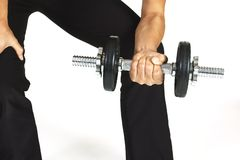 Wrist Curl. A female fitness instructor demonstrates a wrist curl using a dumbbell Stock Image