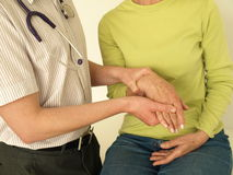 Wrist examination Stock Photography